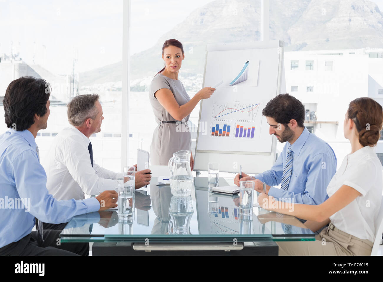 Business woman giving a presentation - Stock Image