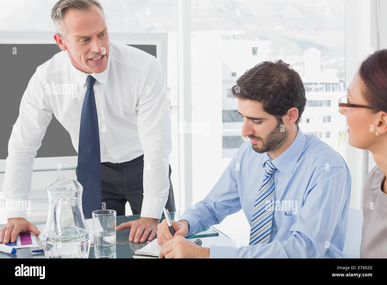 Businessman talking about serious issues - Stock Image