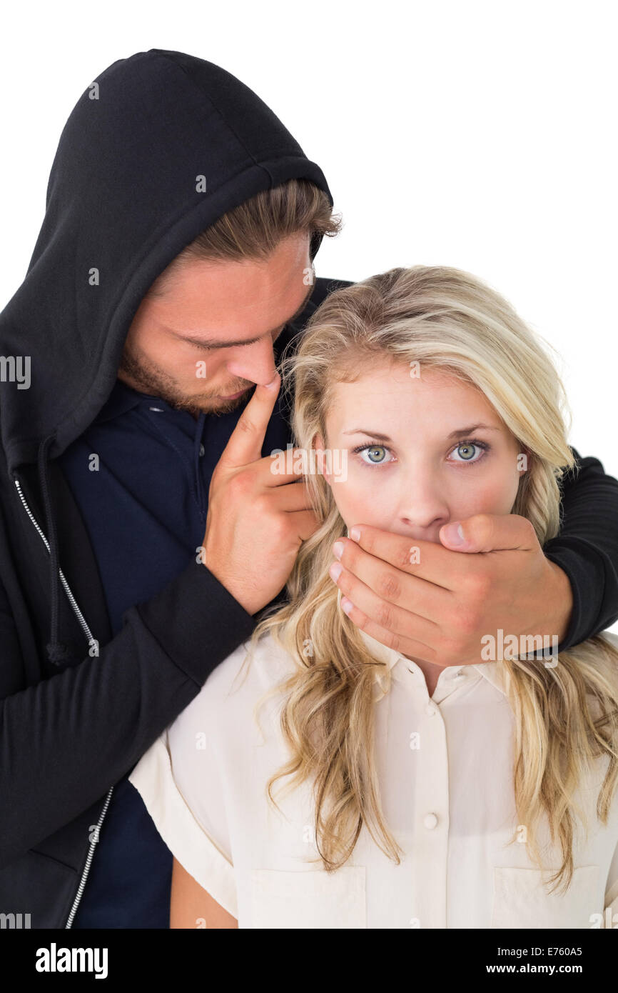 Theft covering young woman's mouth - Stock Image