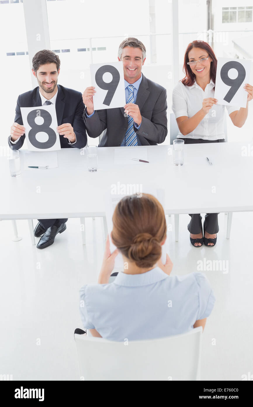 Businesswoman getting her interview rating - Stock Image