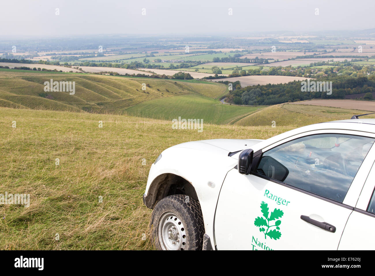 National Trust ranger's vehicle on White Horse Hill and the distant Giant's Steps, Wiltshire, England, UK Stock Photo