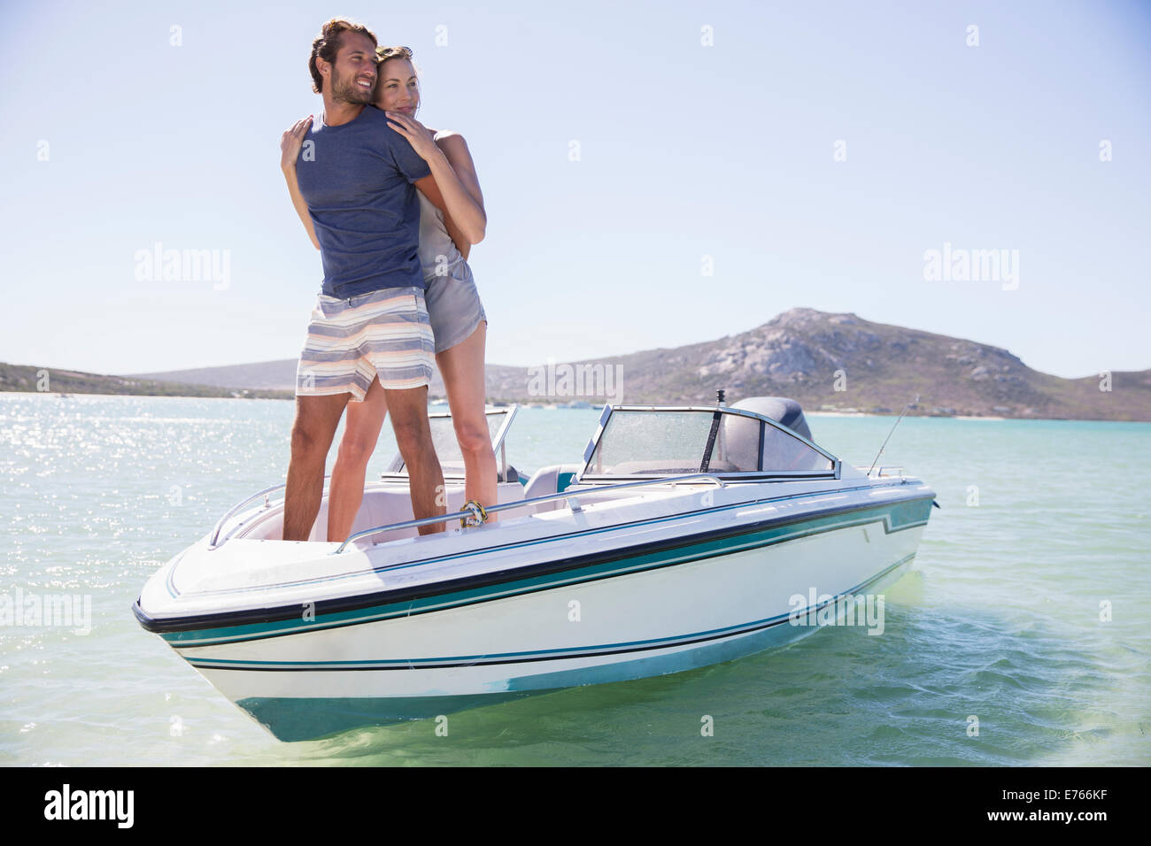 Couple standing on boat together - Stock Image