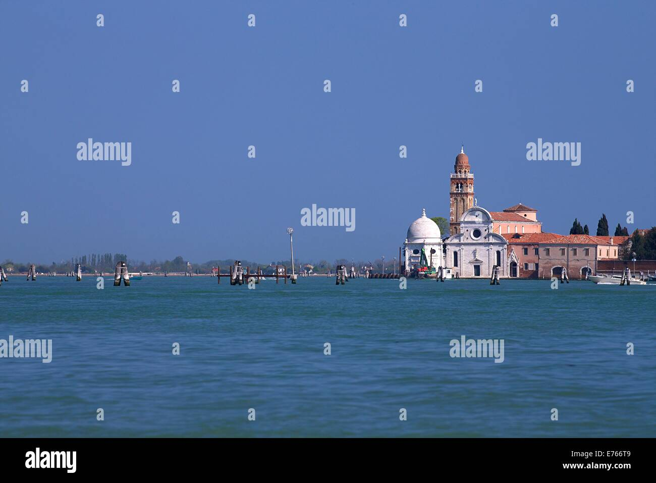 Church of San Michele in Isola in summer sun, cemetery island of San Michele, Venice, Italy, Europe - Stock Image