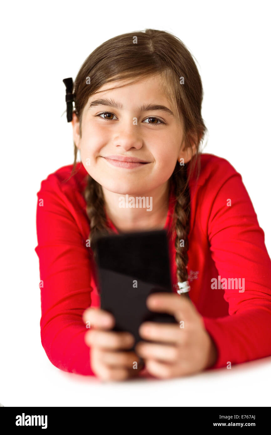 Cute little girl using smartphone - Stock Image