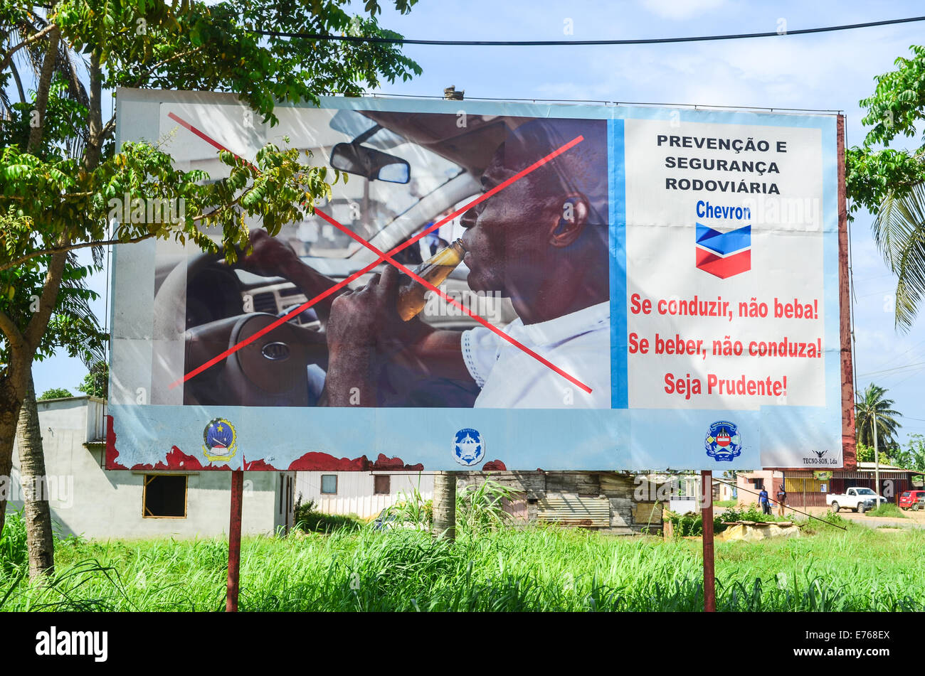 A prevention road sign by the American oil company Chevron warning against drunk driving in Angola, Africa - Stock Image