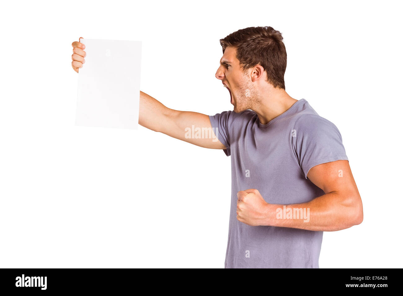 Angry man shouting at piece of paper - Stock Image