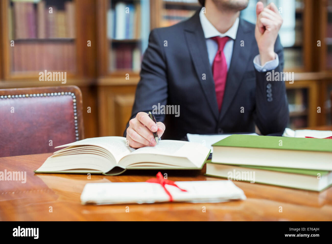 Lawyer doing research in chambers - Stock Image
