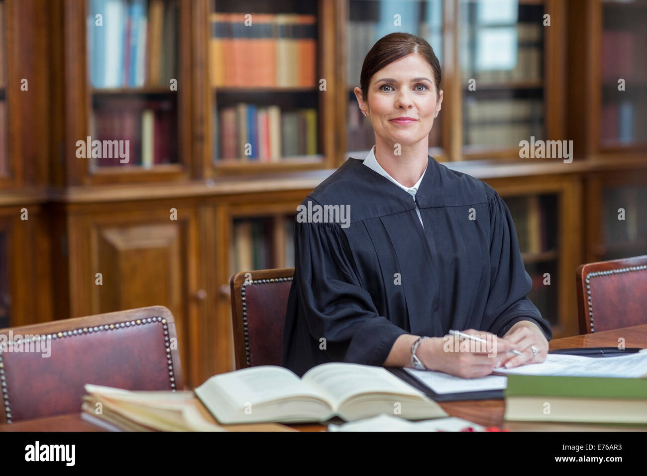 Judge doing research in chambers - Stock Image