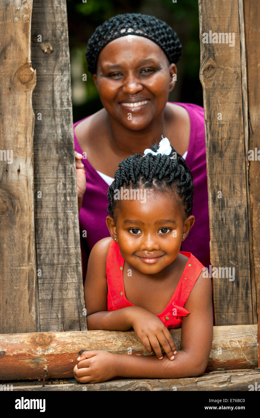 Close up family portrait of African mother with daughter outdoors. - Stock Image