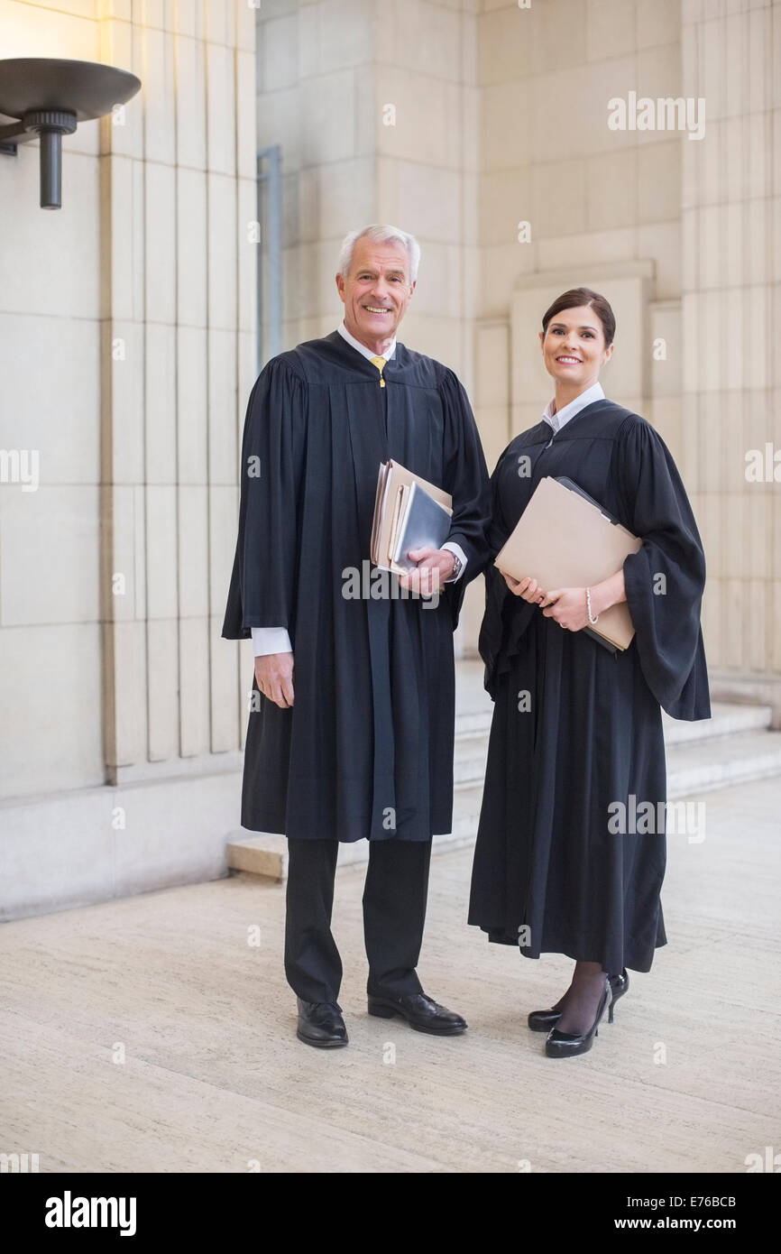 Judges standing together in courthouse - Stock Image