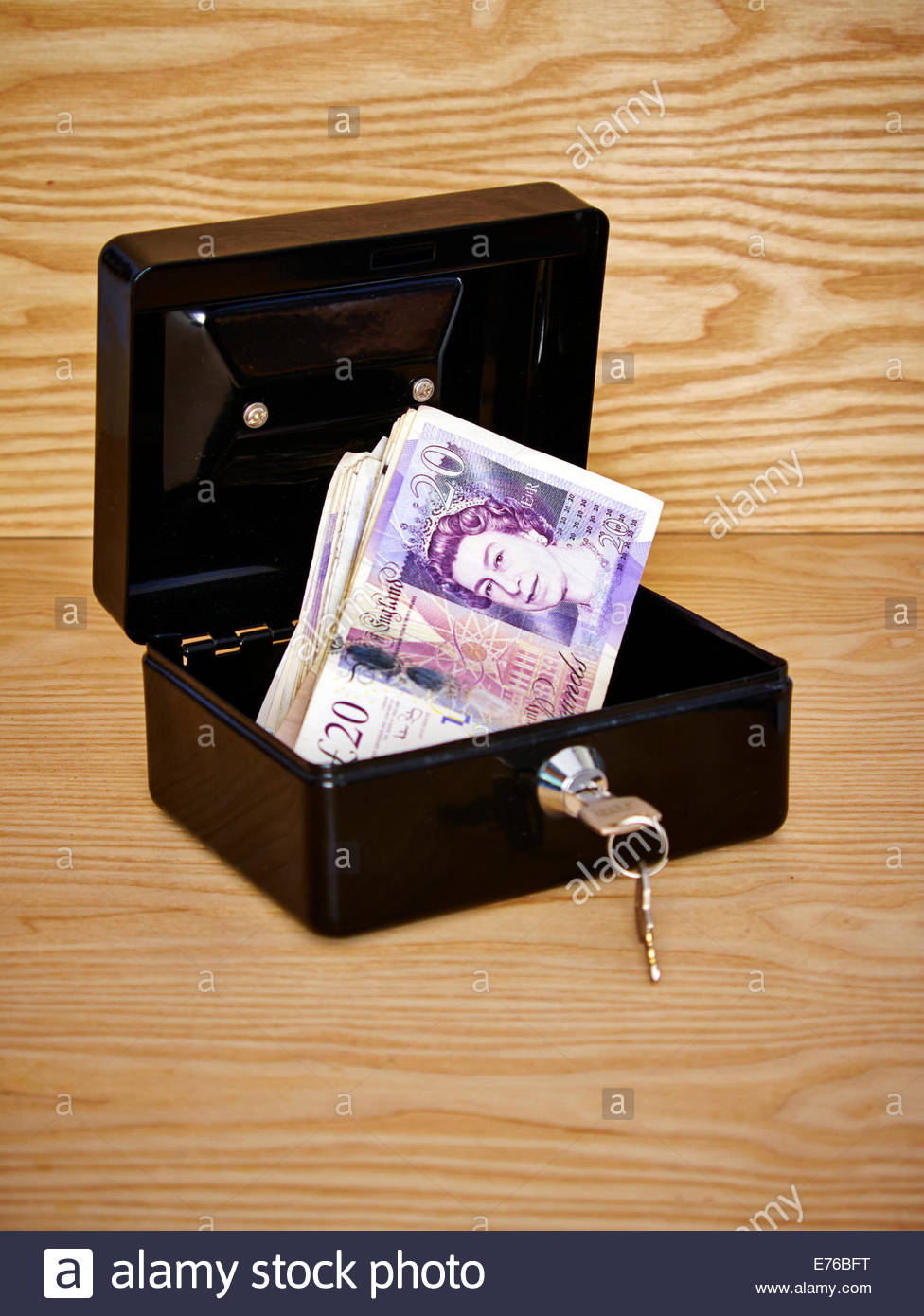black metal cash box filled with GDP british £20 pound notes - Stock Image