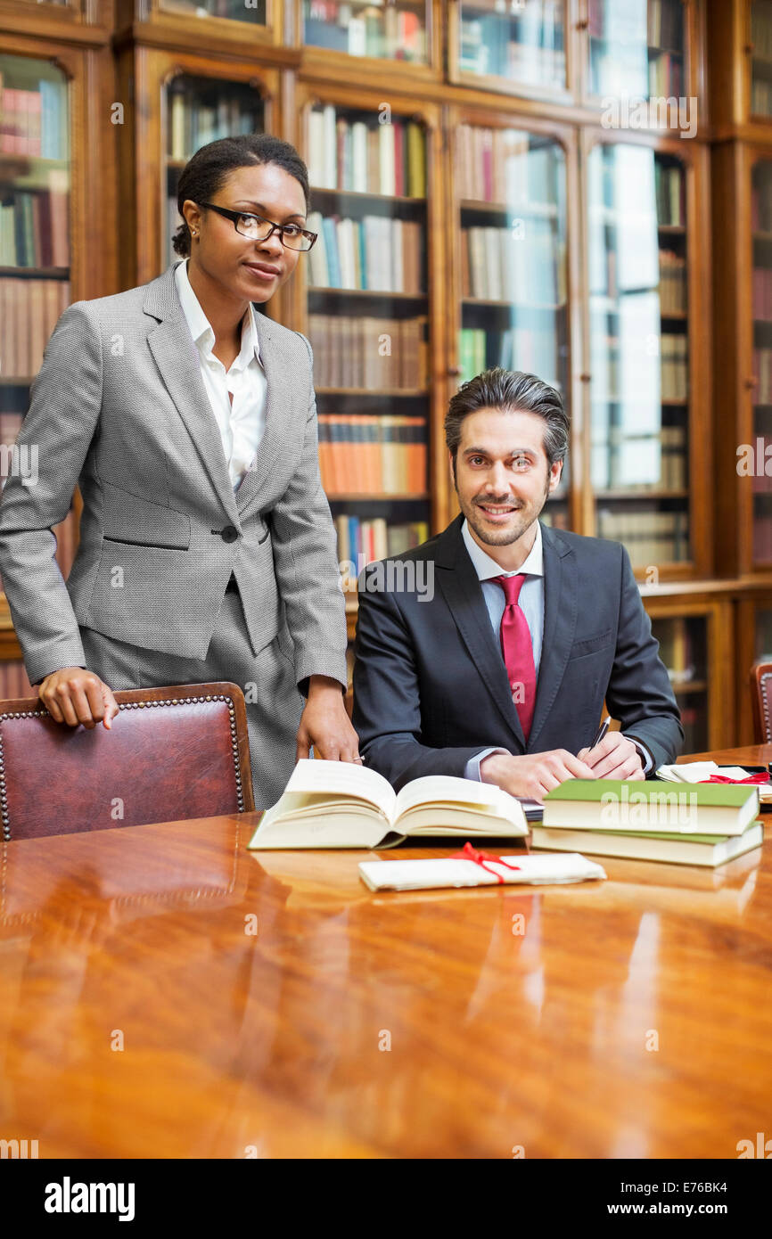 Lawyers doing research together in chambers - Stock Image