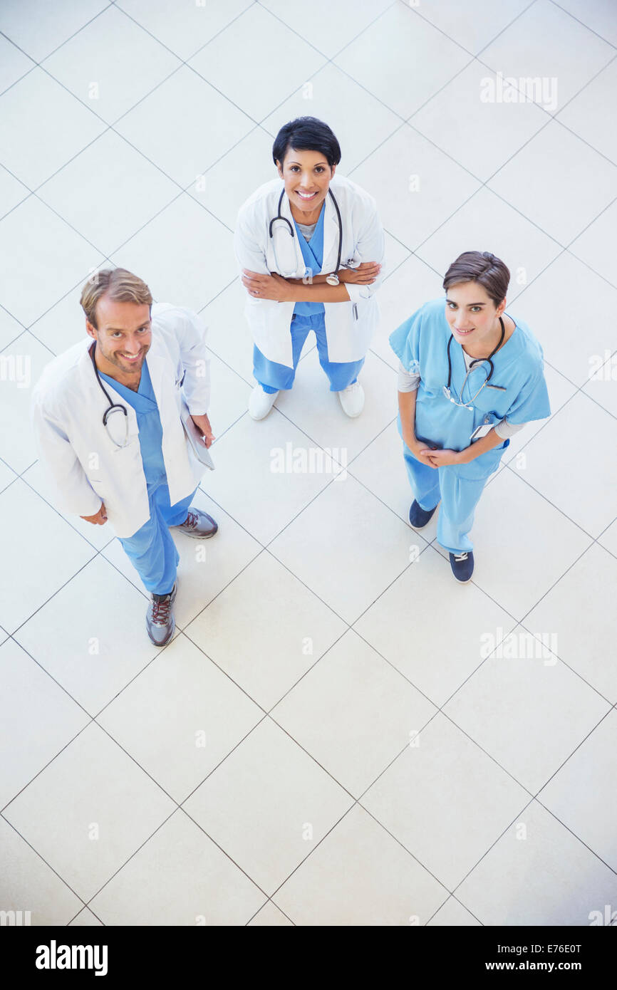 Doctors and nurse smiling in hospital - Stock Image