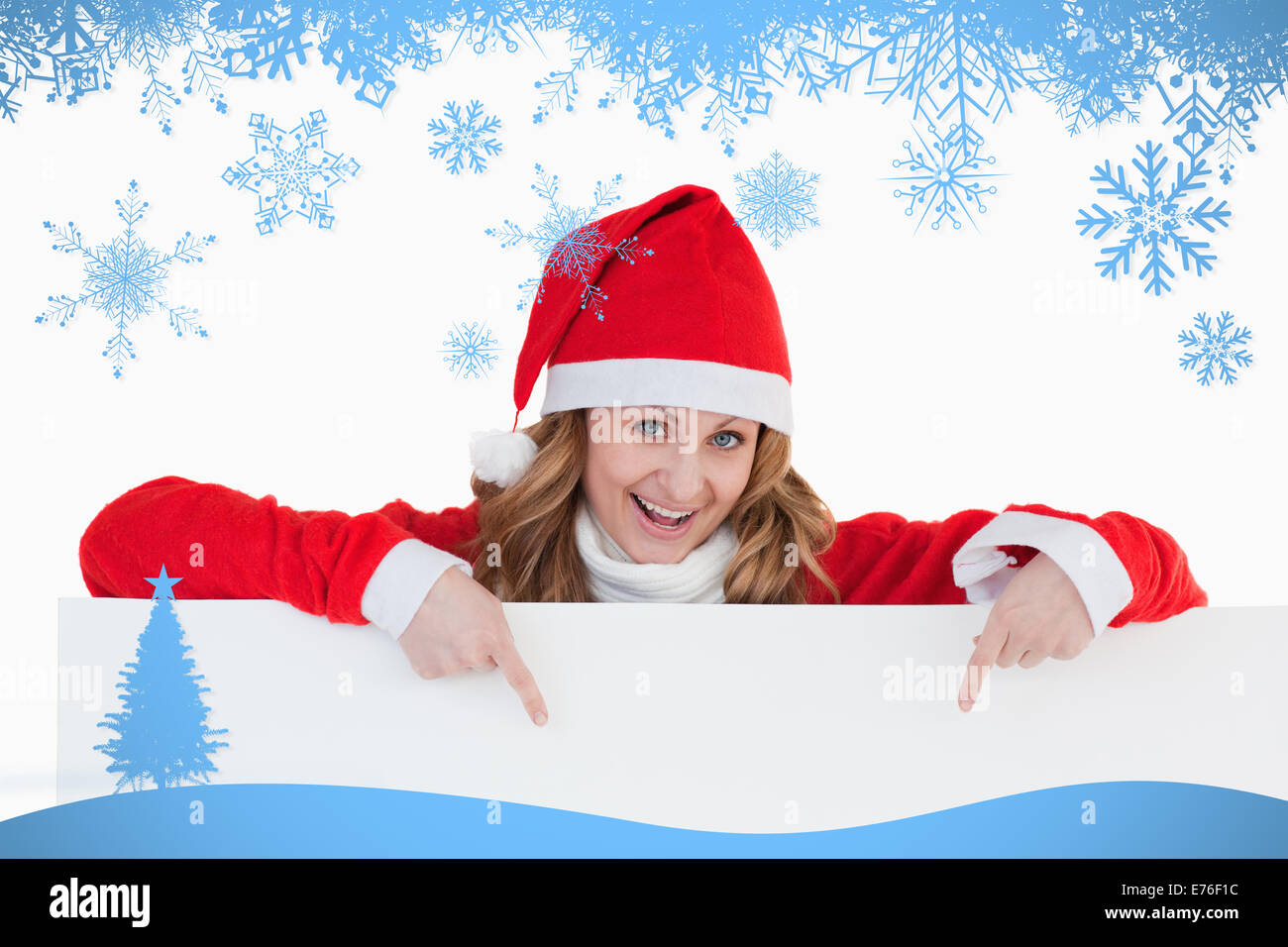Composite image of attractive blondhaired woman dressed as santa claus - Stock Image