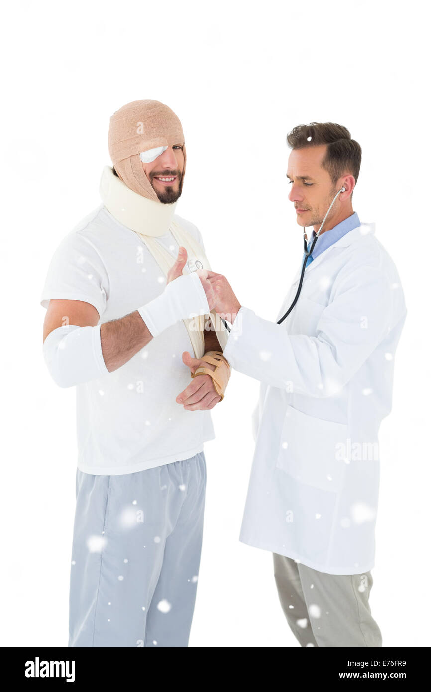 Composite image of doctor auscultating patient tied up in bandage with stethoscope - Stock Image