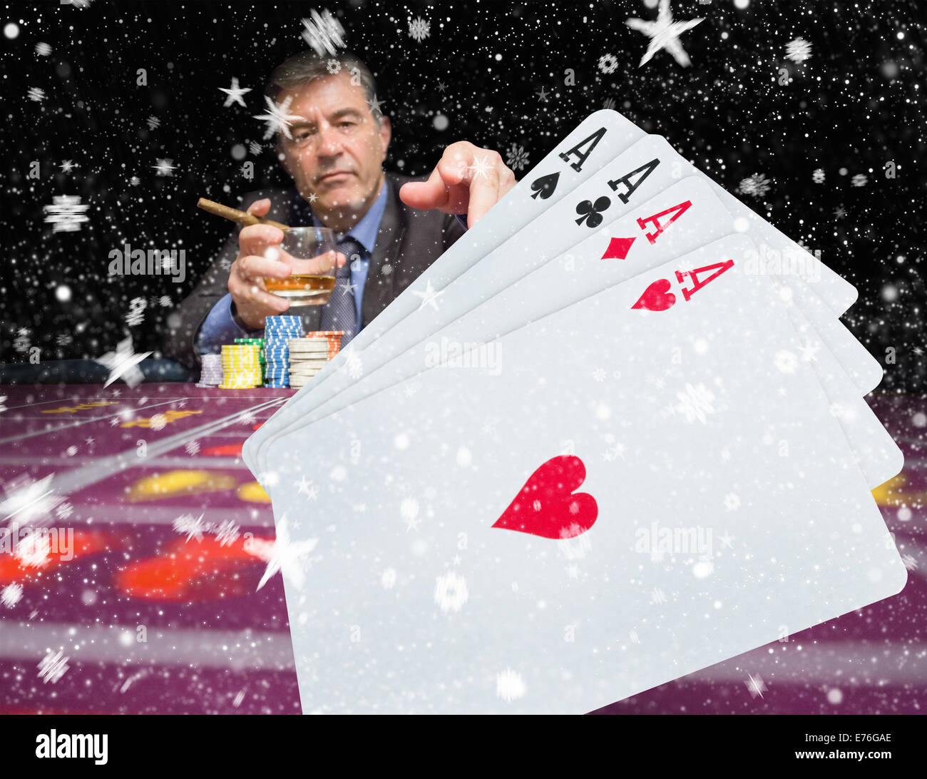 Composite image of gambler holding whiskey at poker table with digital hand of cards in foreground - Stock Image