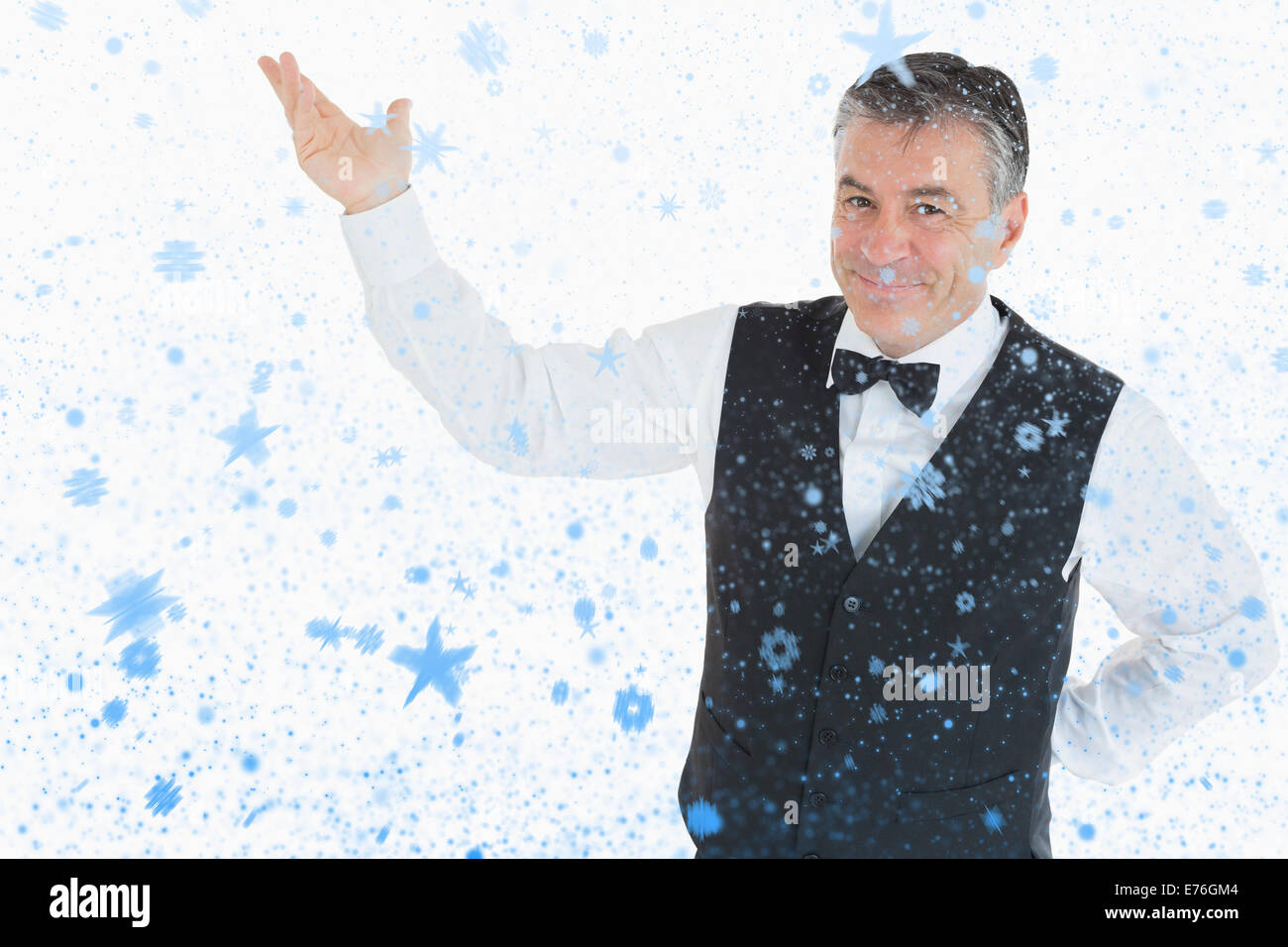 Composite image of smiling man pointing to something - Stock Image