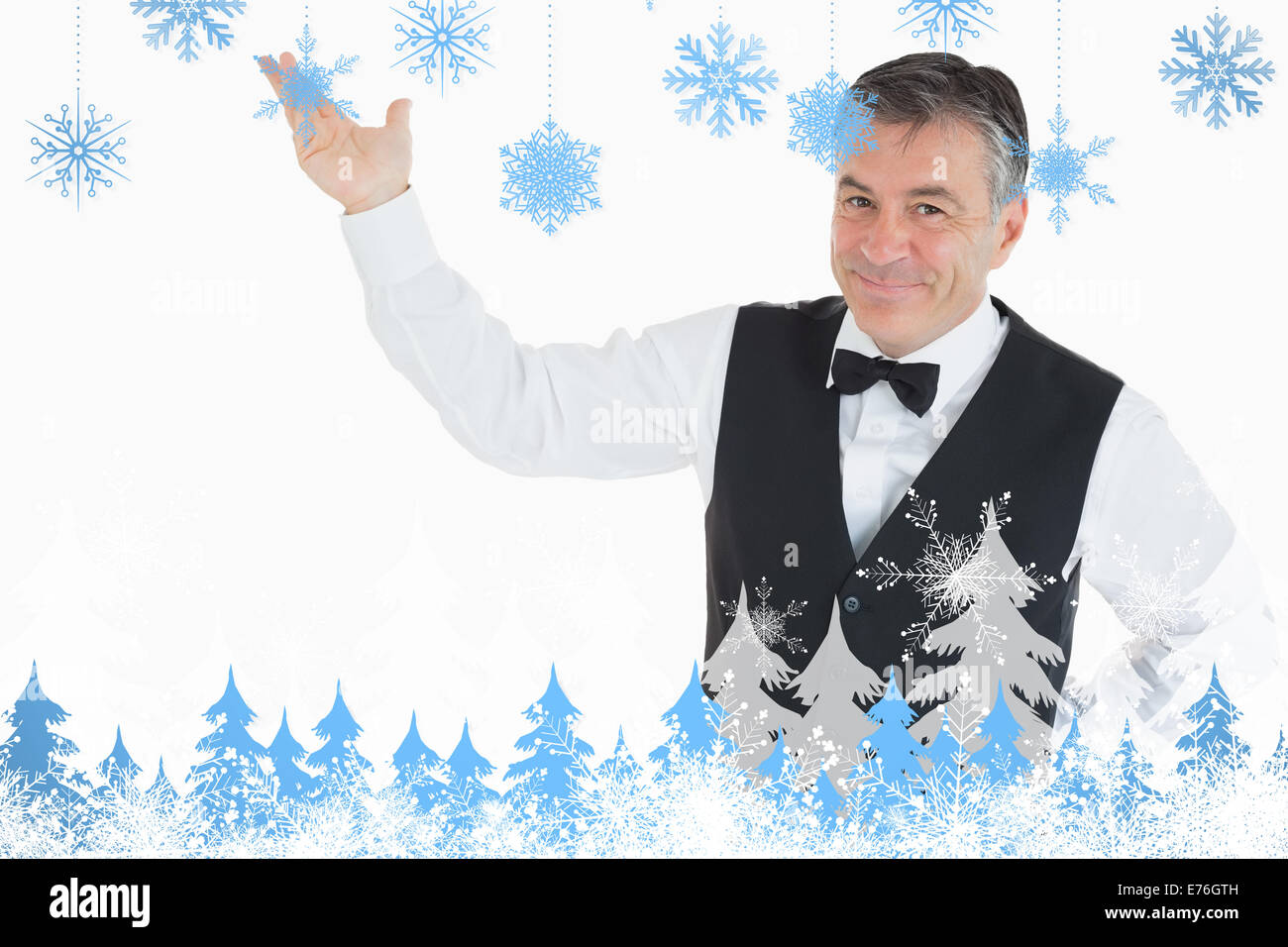 Composite image of smiling man pointing to something Stock Photo