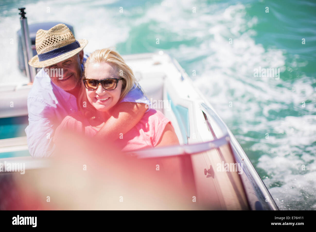 Couple sitting in boat together - Stock Image