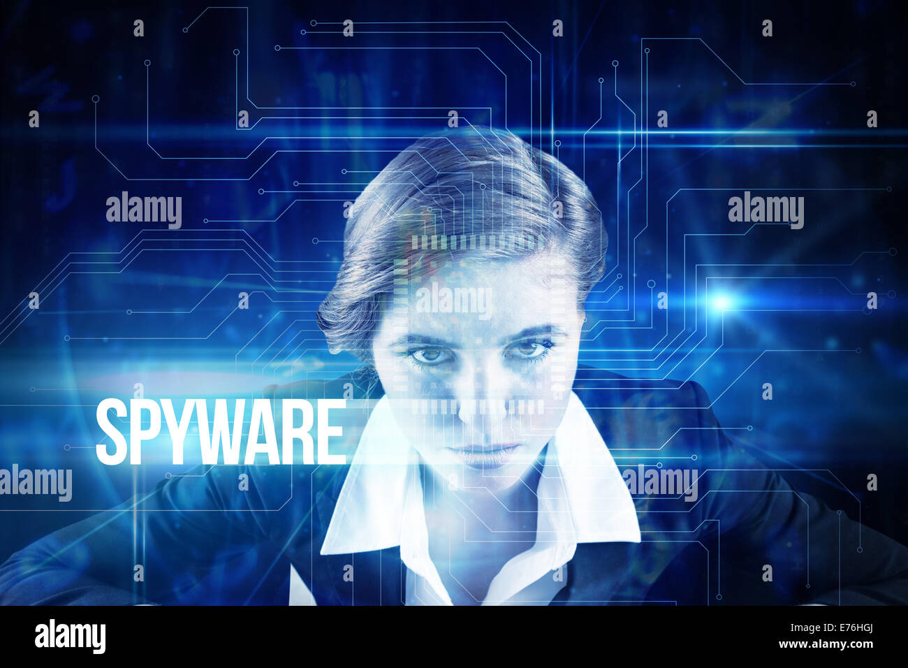 Spyware against blue technology interface with circuit board - Stock Image