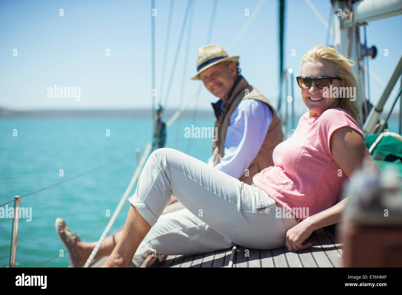 Couple relaxing on deck of sailboat Stock Photo