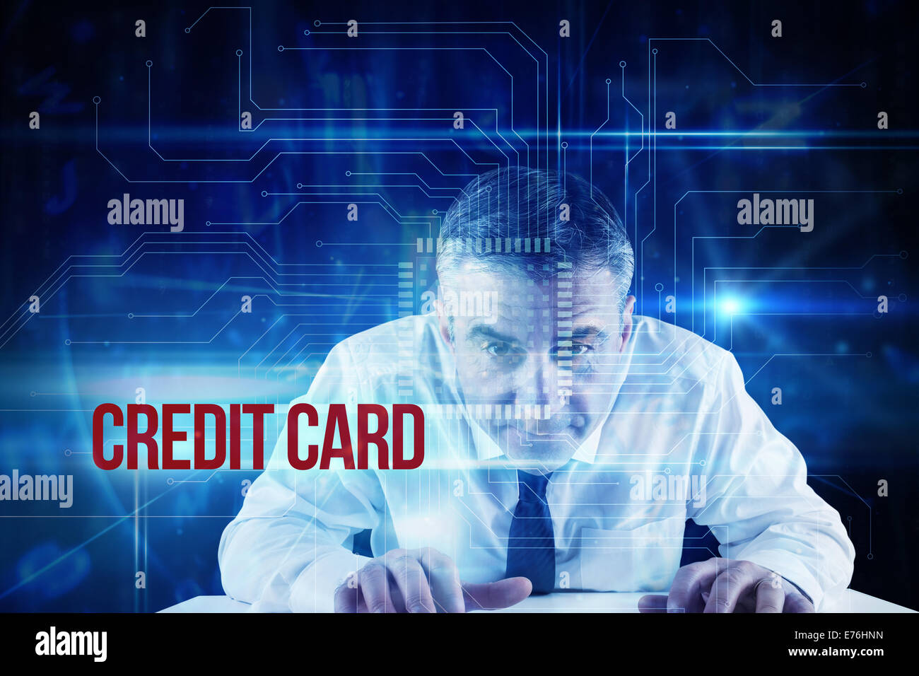 Credit card against blue technology interface with circuit board - Stock Image