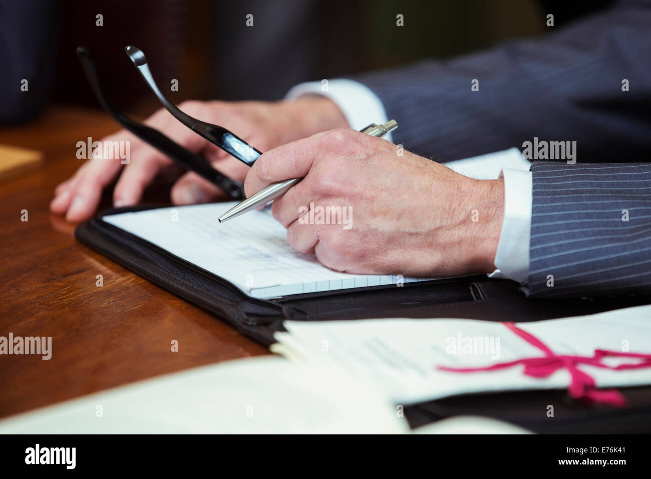 Close up of lawyers hands in courtroom - Stock Image