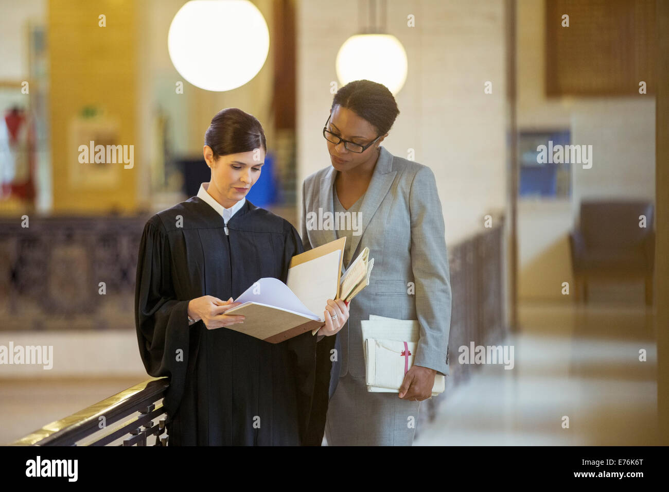 Judge and lawyer looking through documents - Stock Image