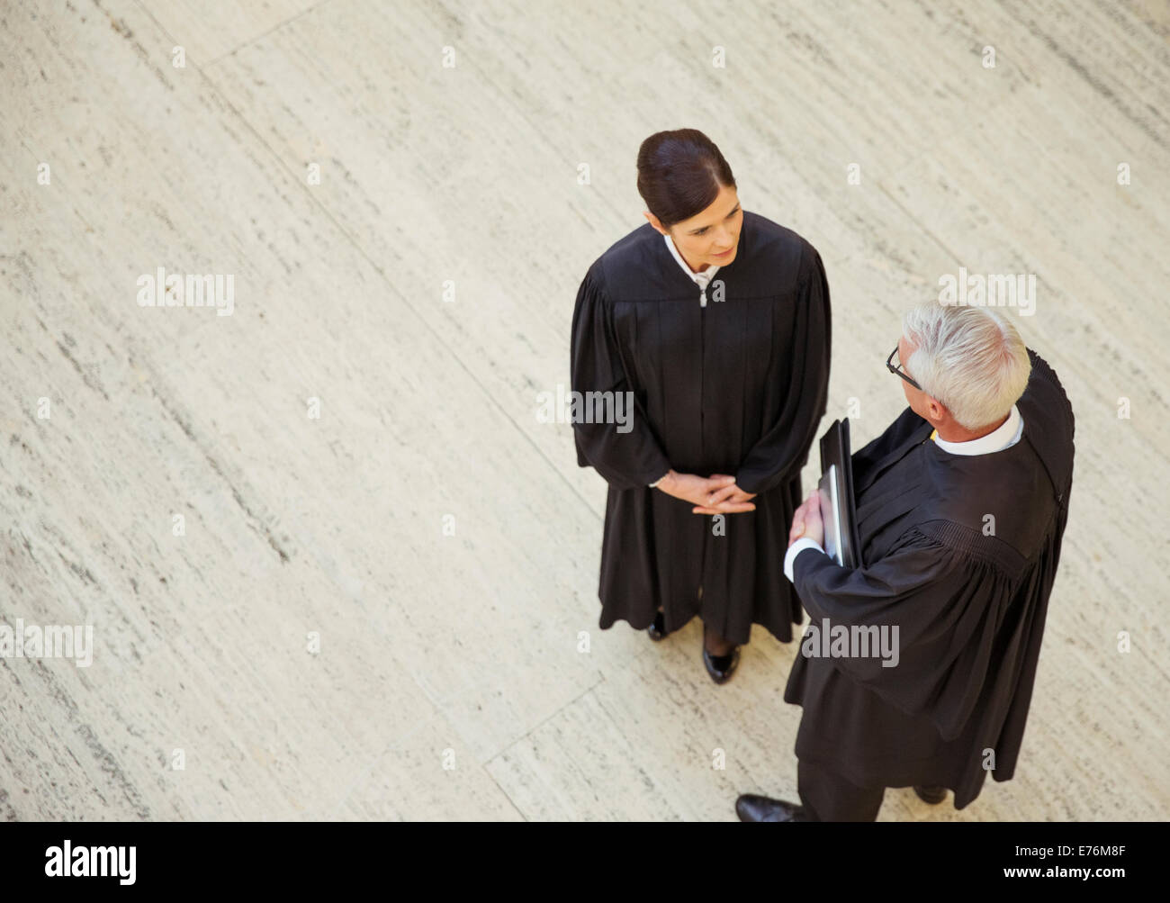 Judges talking in courthouse - Stock Image