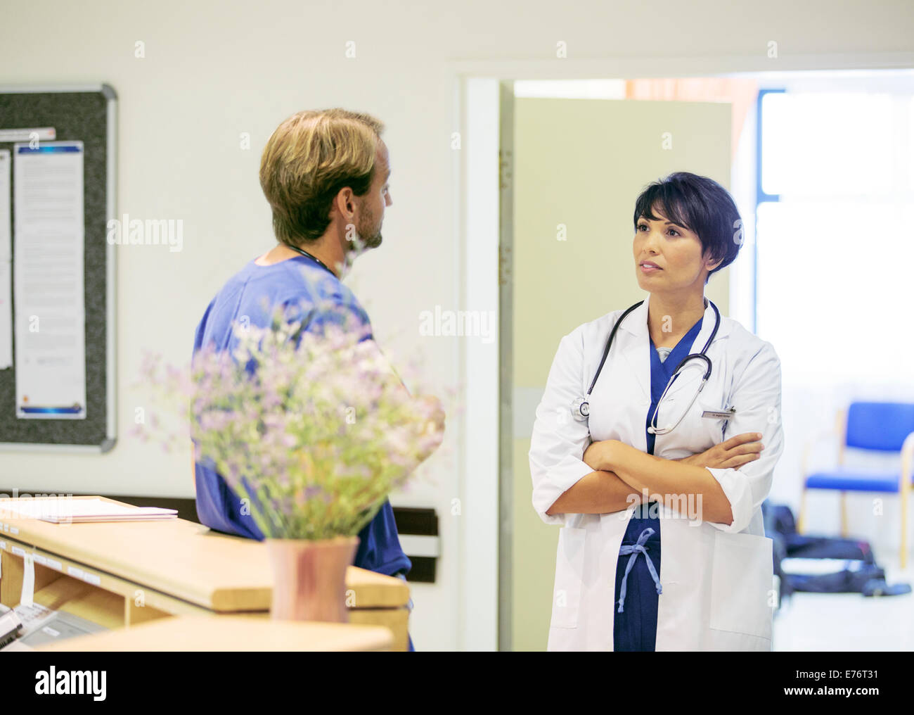 Doctor and nurse talking in hospital - Stock Image
