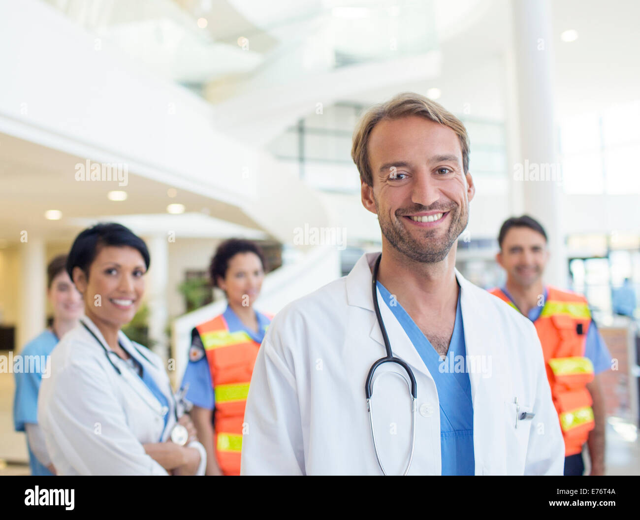 Doctors smiling in hospital - Stock Image