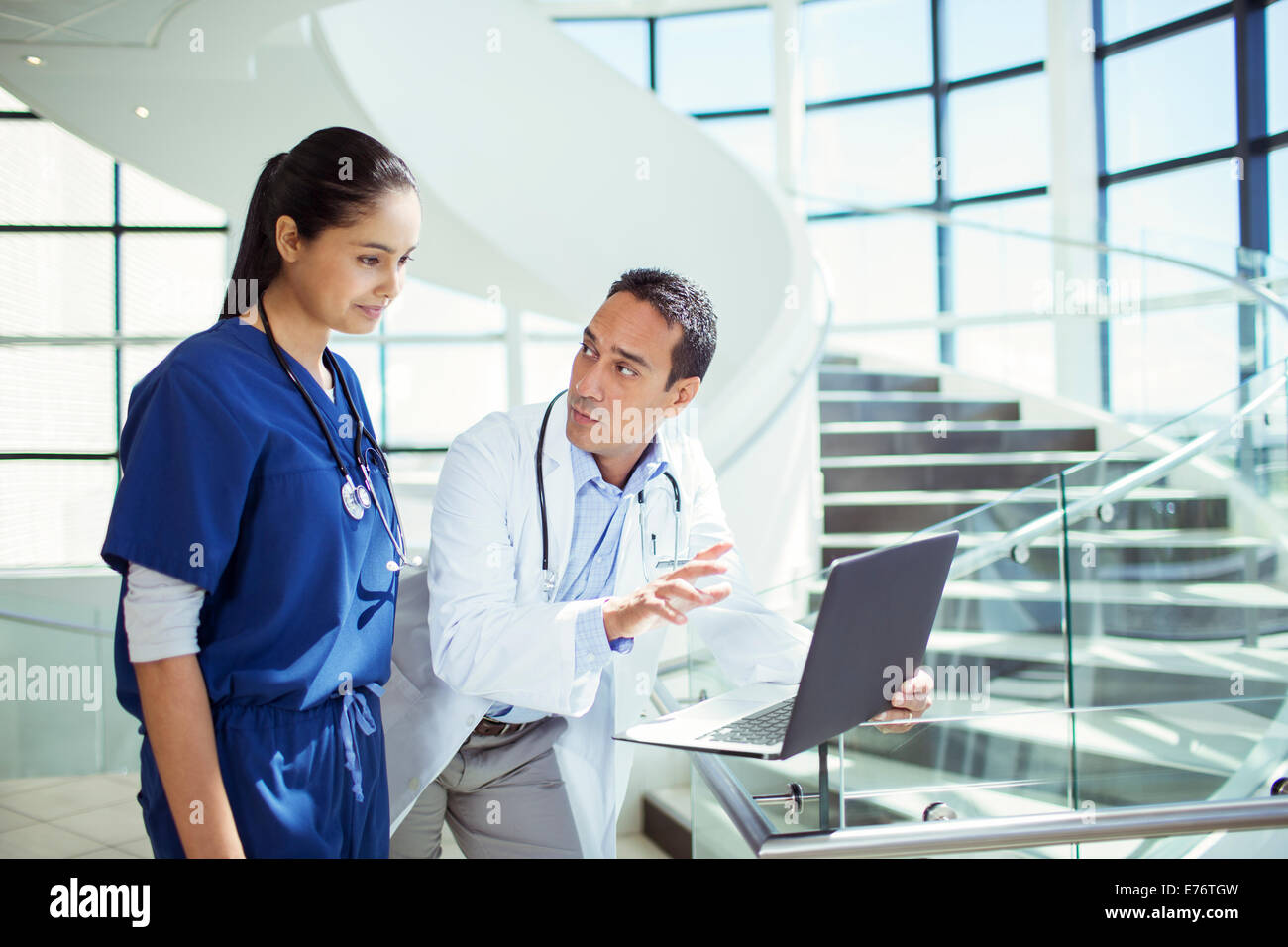 Doctor and nurse using laptop in hospital - Stock Image