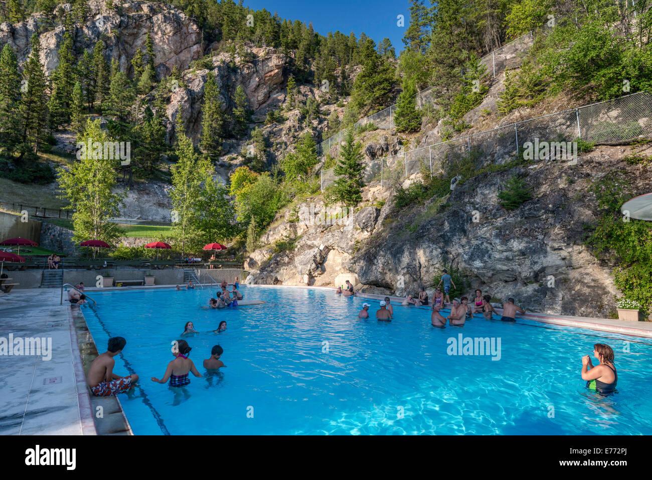 Hot water pool for soaking outdoors at Radium Hot Springs, resort at Kootenay National Park, Canadian Rockies, British - Stock Image