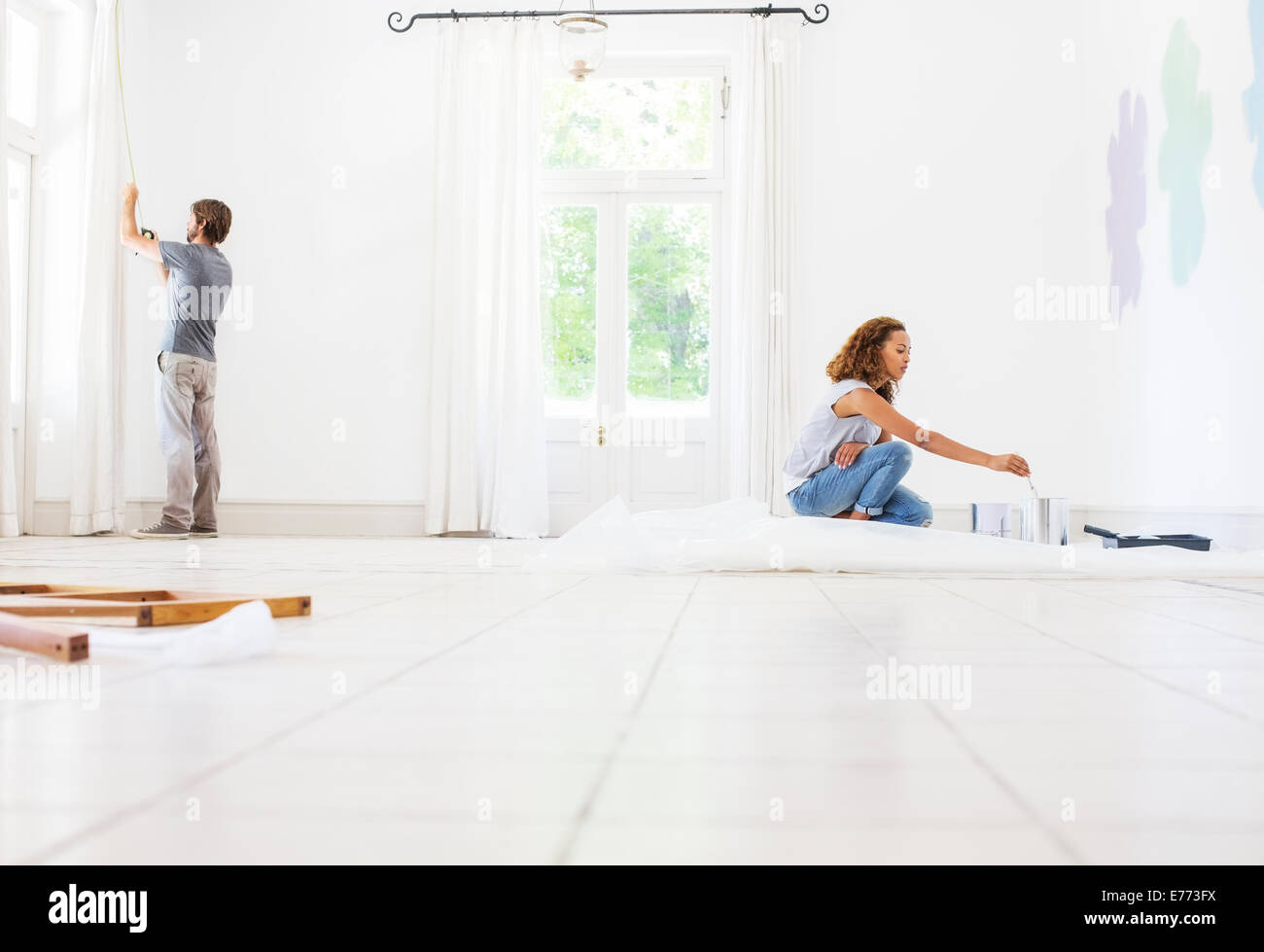 Couple fixing up new home - Stock Image