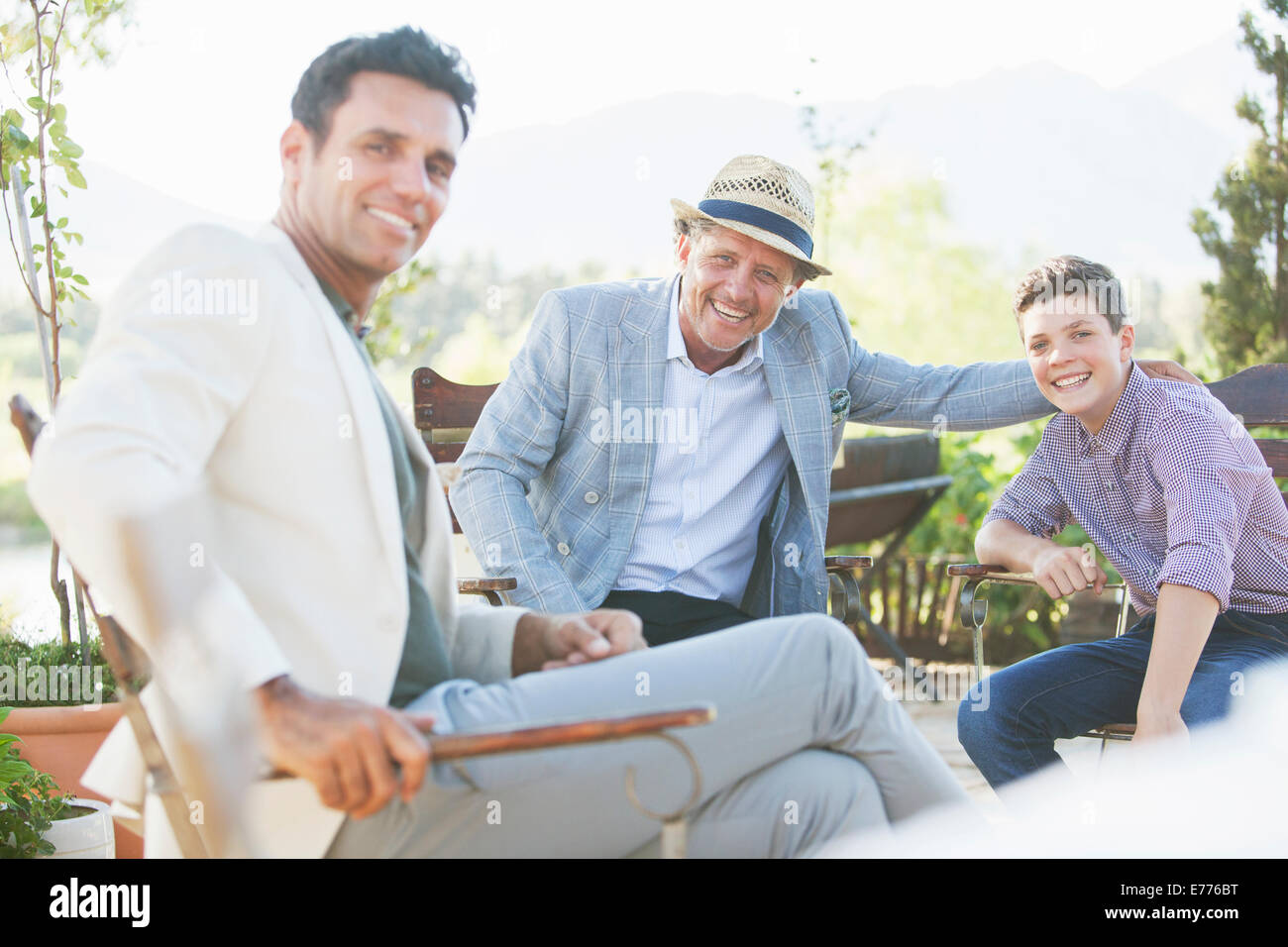 Three generations of men relaxing outdoors Stock Photo