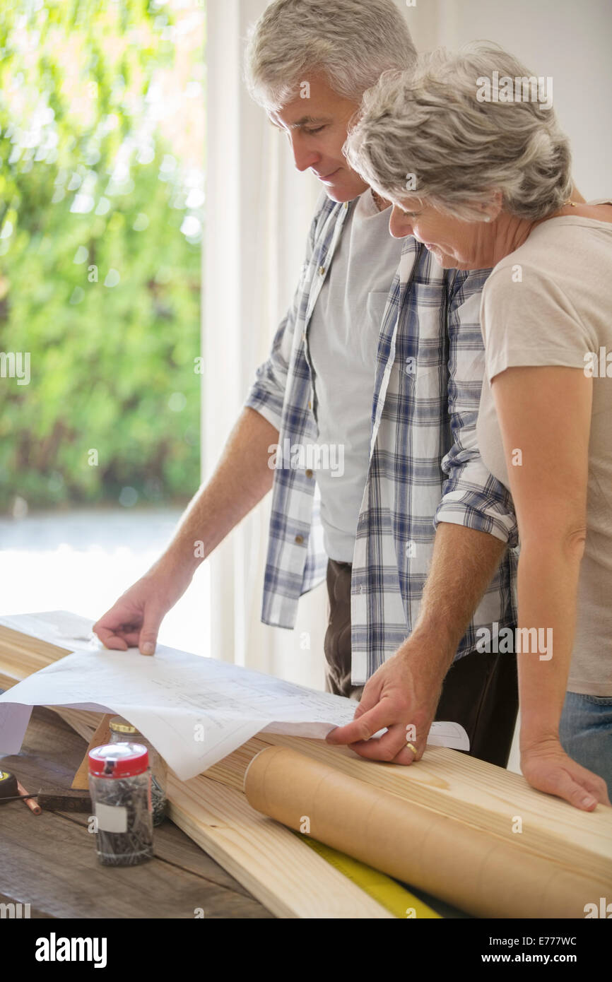Older couple looking through documents together - Stock Image