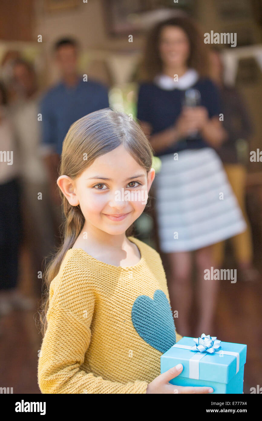 Young girl holding gift - Stock Image