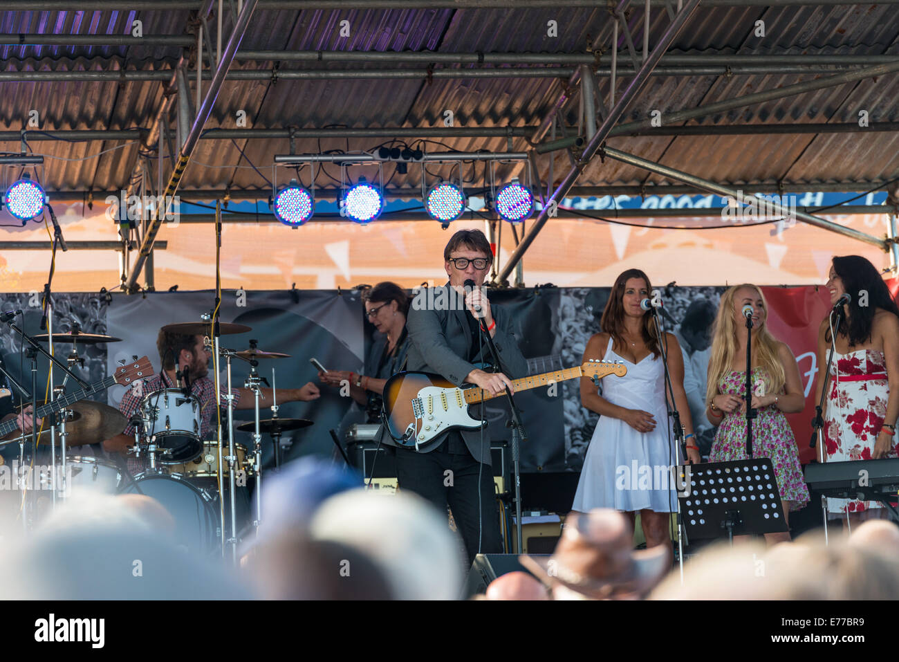 Lyme Regis Dorset England. Billy Geraghty takes to the stage and performs Buddy Holly songs at the Guitars on the - Stock Image