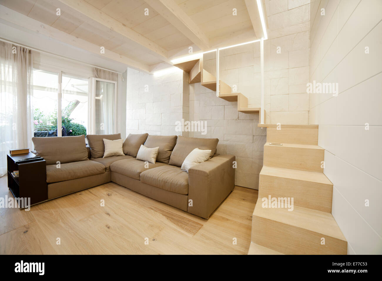 Modern Living Room With Stairs To A Hidden Space Upstairs Stock