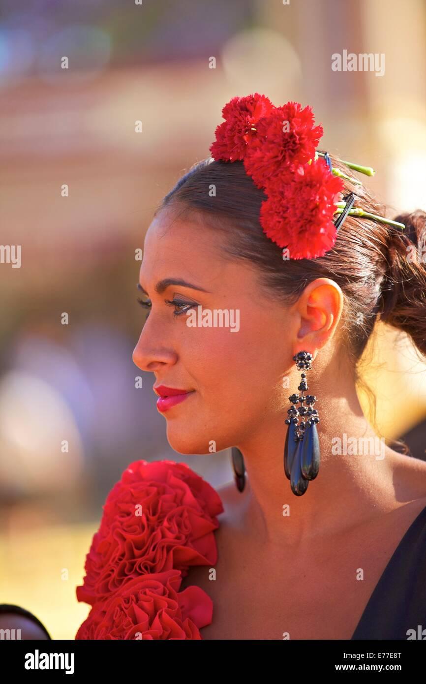 Flamenco Dancer in Traditional Dress, Annual Horse Fair, Jerez de la Frontera, Cadiz Province, Andalusia, Spain - Stock Image