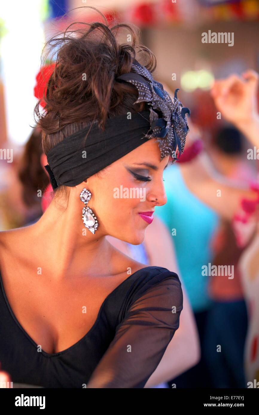 Flamenco Dancer in Traditional Dress, Annual Horse Fair, Jerez de la Frontera, Cadiz Province, Andalusia, Spain - Stock Image