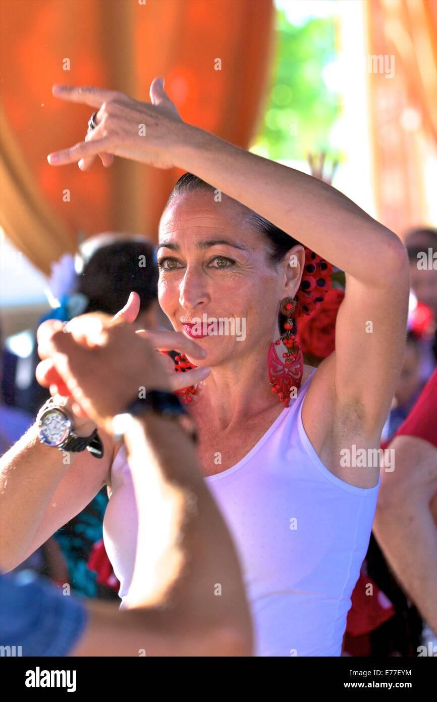 Flamenco Dancer in Traditional Dress, Annual Horse Fair, Jerez de la Frontera, Cadiz Province, Andalusia, Spain Stock Photo