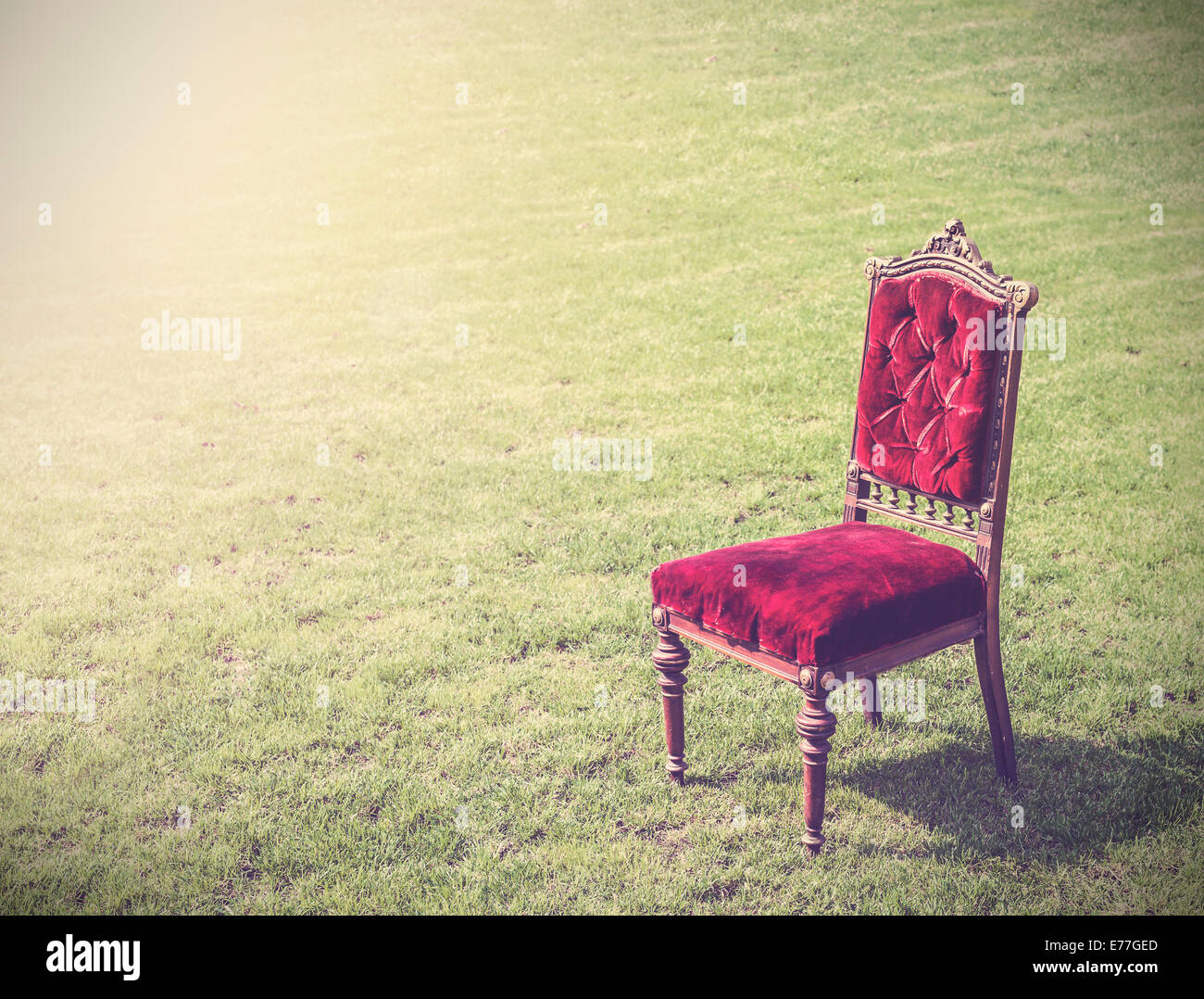 Vintage antique old red chair on green grass, abstract background. - Stock  Image - Antique Chair Grass Stock Photos & Antique Chair Grass Stock Images