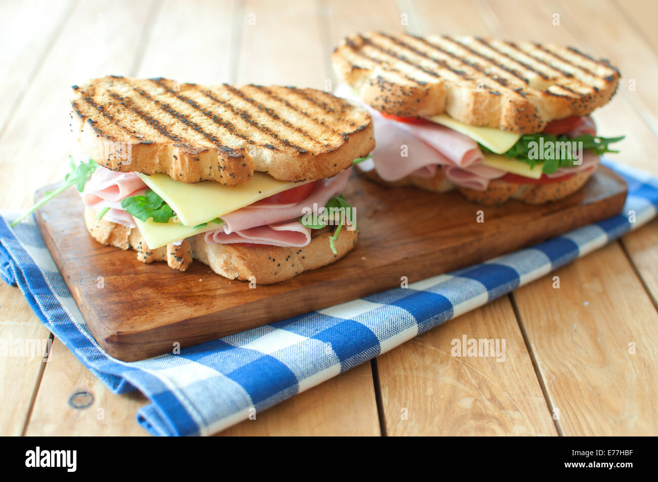 Grilled sandwiches with ham and cheese - Stock Image
