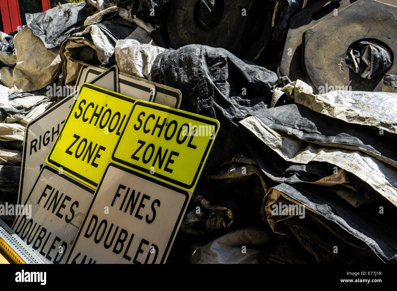 multiple 'school-zone' 'fines-doubled' road signs at construction site - Stock Image