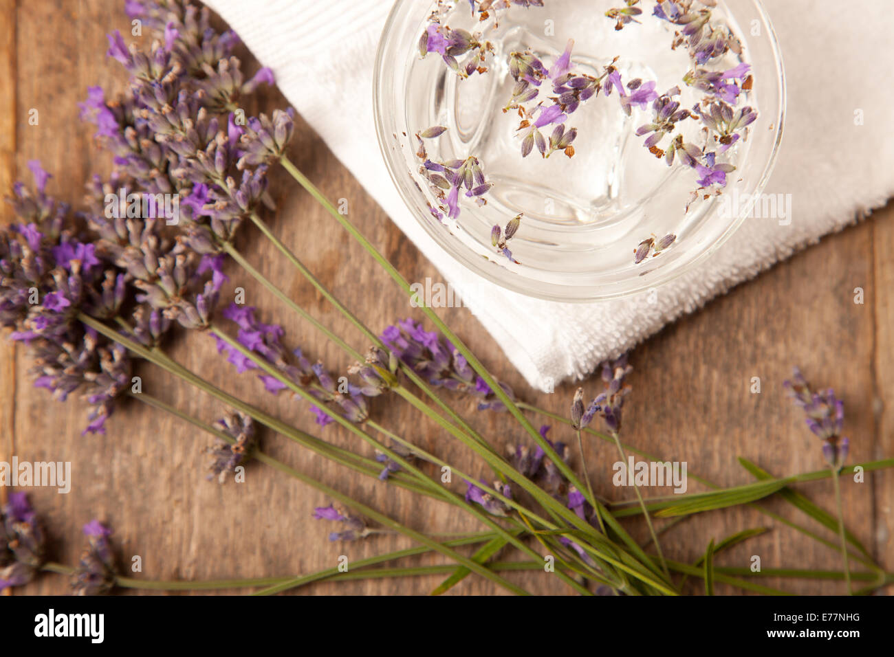 lavenders in the bowl of water on wooden table - Stock Image