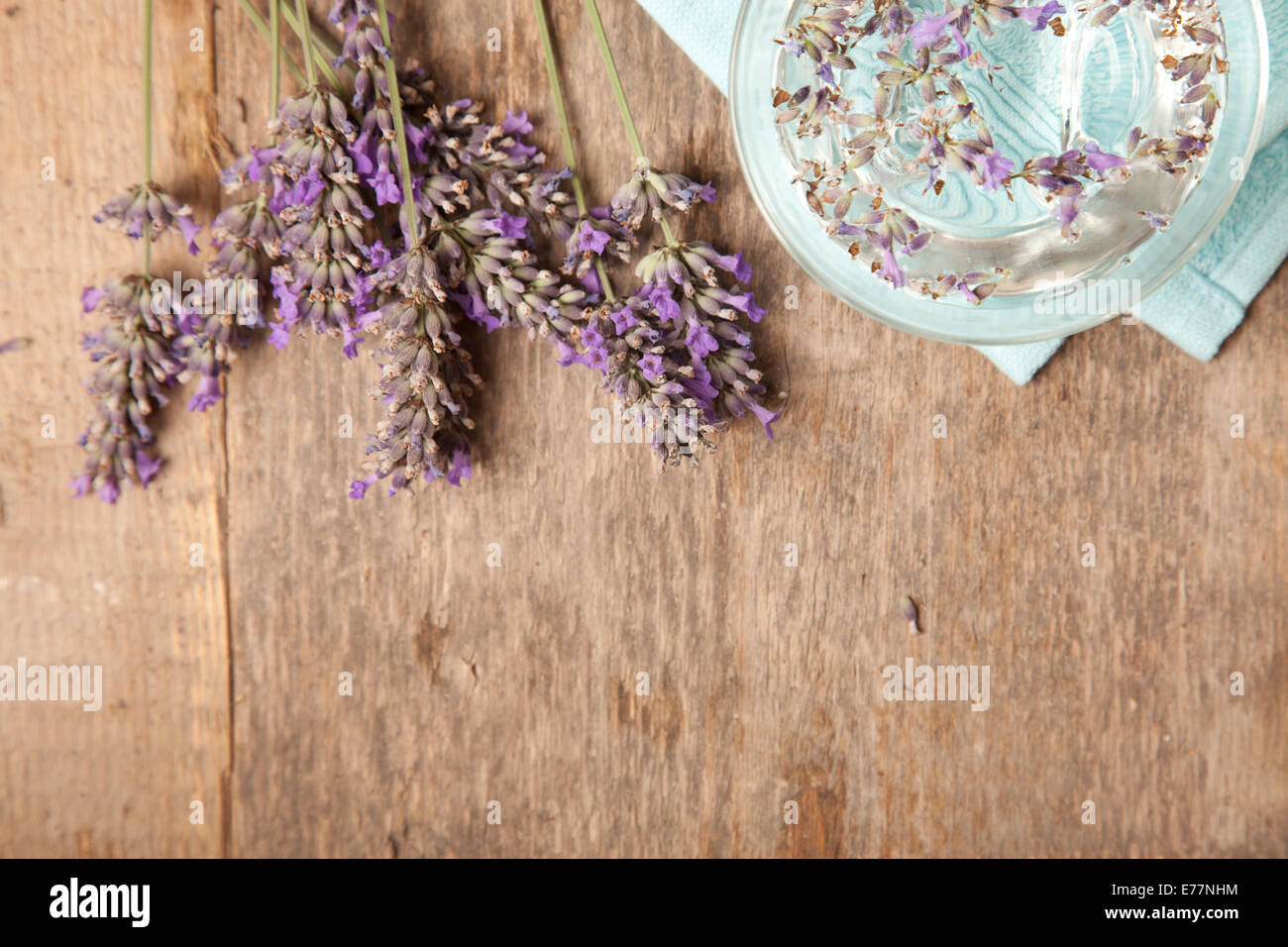 nice wooden background of lavenders and blue towel - Stock Image