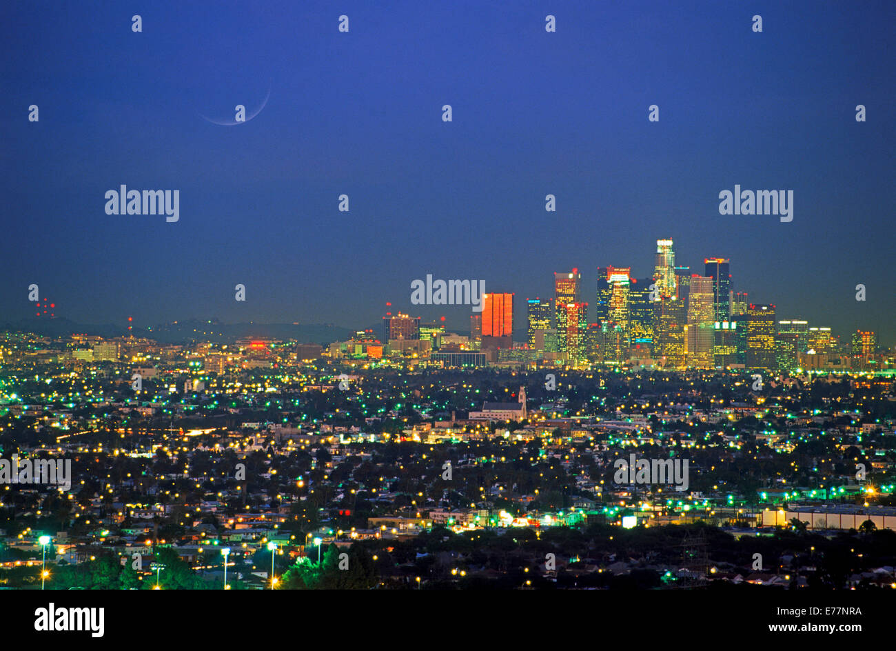 Los Angeles Civic Center and city lights at dusk from Griffith Park Observatory - Stock Image