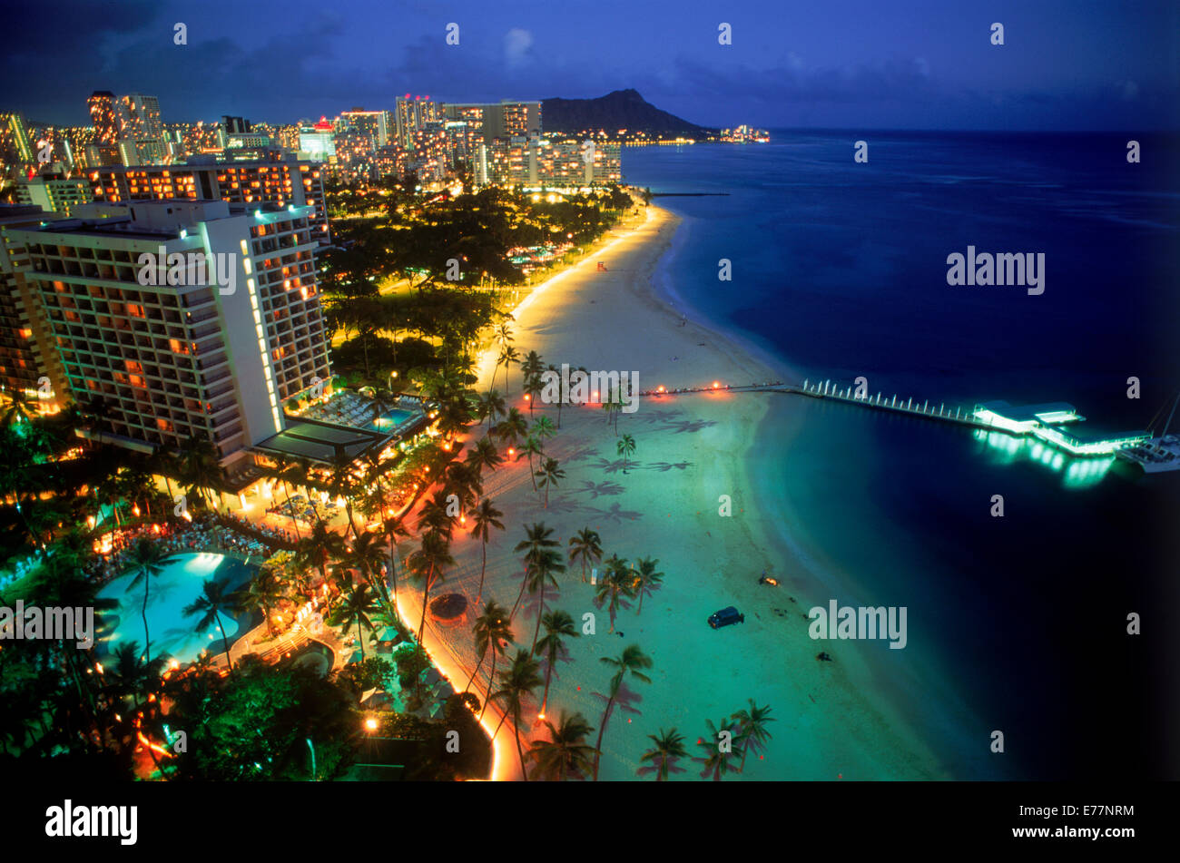 Overview of Waikiki beaches with Diamond Head at twilight - Stock Image