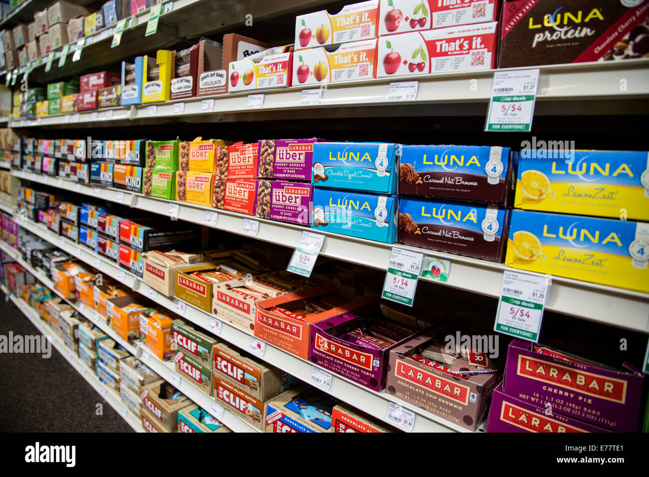 A natural foods grocery store aisle with shelves  of power protein bars. - Stock Image